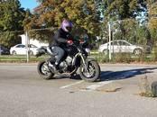 Moto transports Cits, Foto